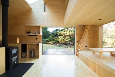 The open-plan cabin interior is designed without any loose furniture that might clutter the solitude.