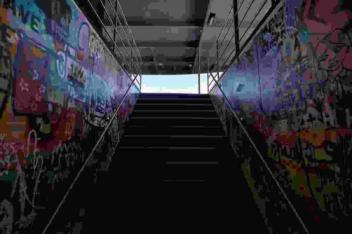 MR-I's graffiti-lined stairwell mimics MONA's darkened descent.