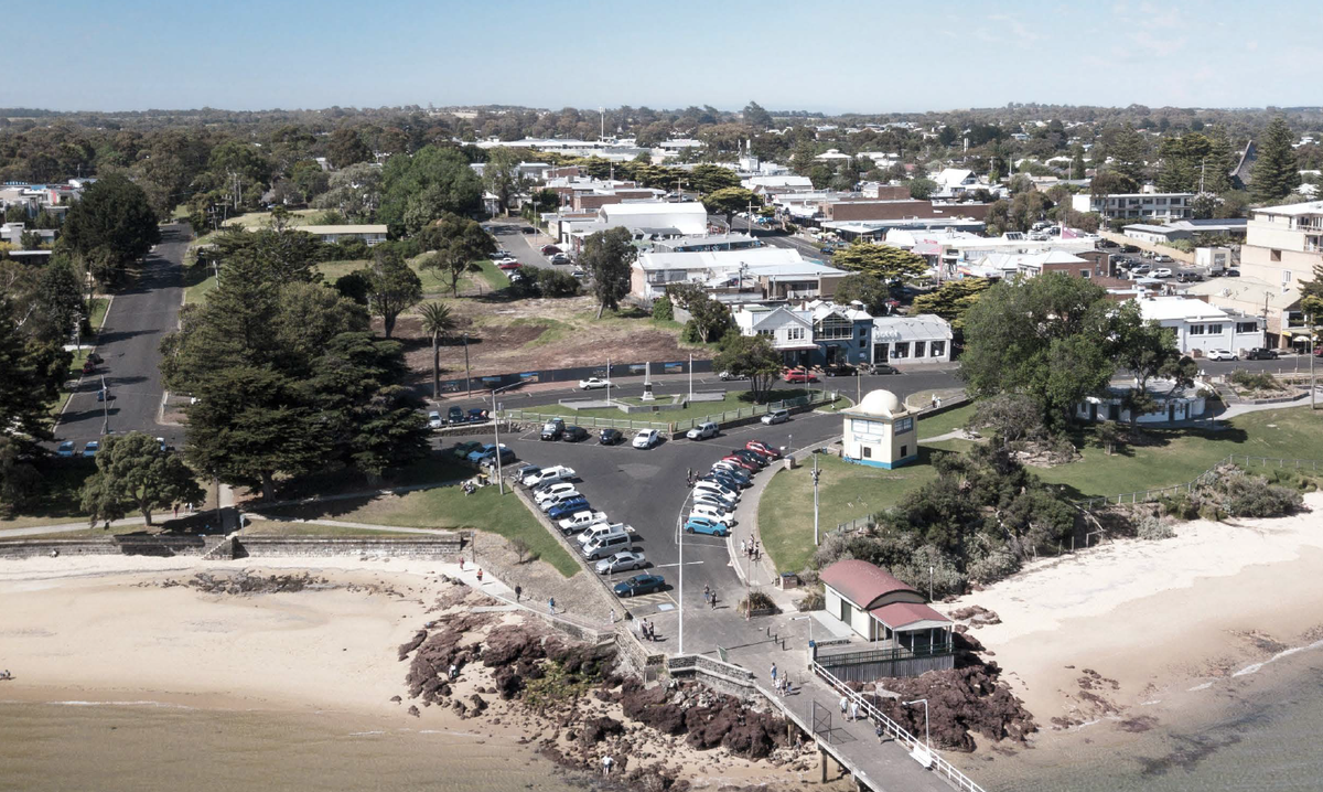 The Cowes Jetty Triangle currently has sparsely planted trees and a dominant carpark.