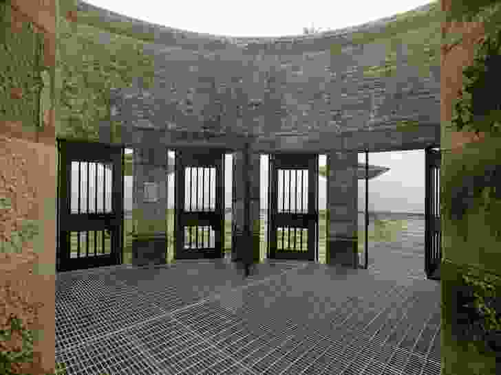 Four identical barred doors in a quadrant of courtyard lead to the exercise yards.