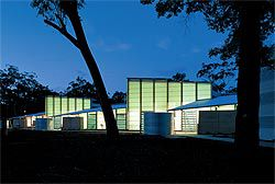 Evening view of the south elevation with light glowing through the translucent walls.Image: Richard Stringer