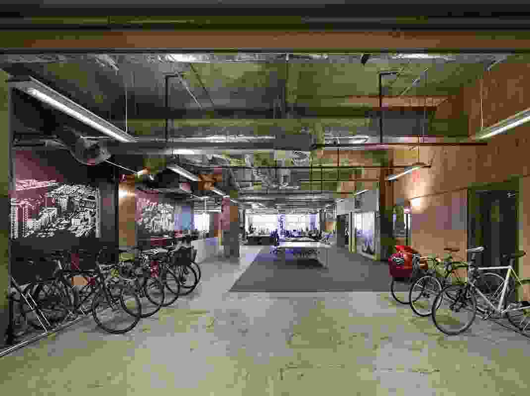 The reception area doubles as bicycle parking. On the left is Scanning Swanston by Louise Forthun, 2010, courtesy Boutwell Draper Gallery. The sculpture on the right is Car Nugget GL Tangerine Dream by  Patricia Piccinii, 2001.