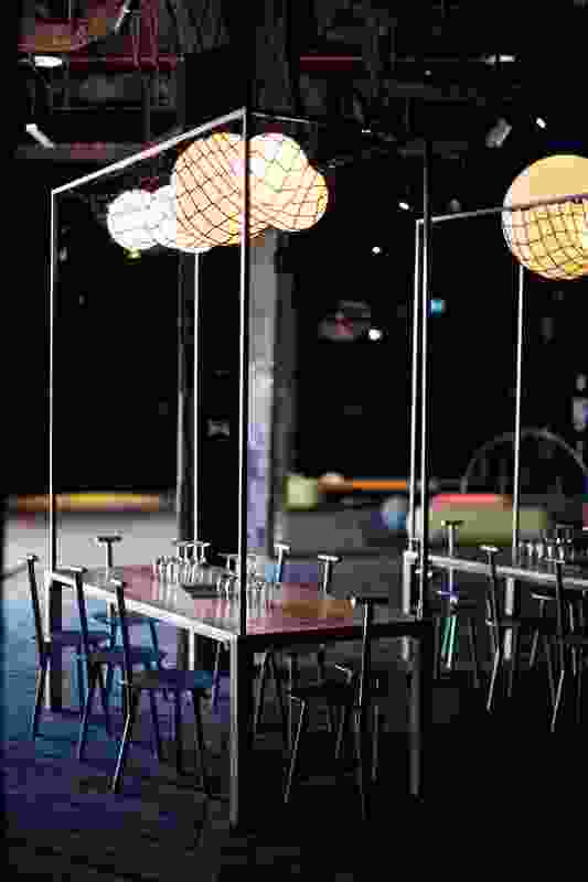 Glowing balls held in nets above the tables are inspired by the shape of grapes.