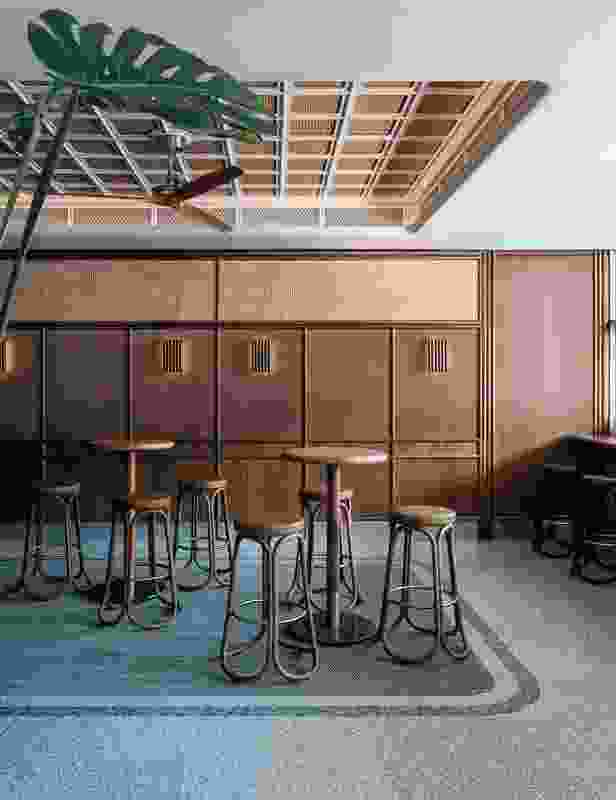 The three interconnected spaces (front bar and two dining spaces behind) use the same materials palette to convey a single statement about the history of the pub.