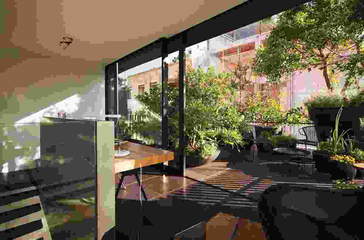 The roof terrace and study on the upper level give the experience of a crowning space.