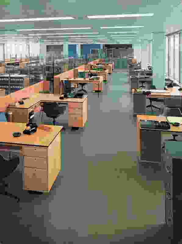 Large floor plates, use of glass and lines of workstations at the ICI House office building in Melbourne, 1958.