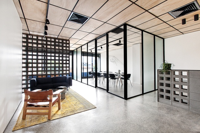 The building company's office features partitions made from concrete blocks.