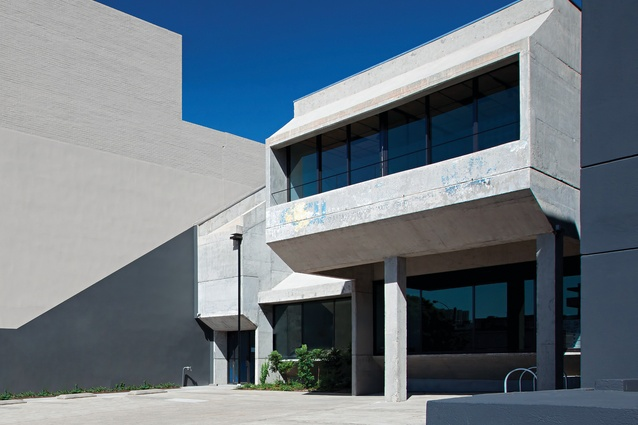 """The offices are housed in a concrete brutalist building that """"only an architect could love."""""""