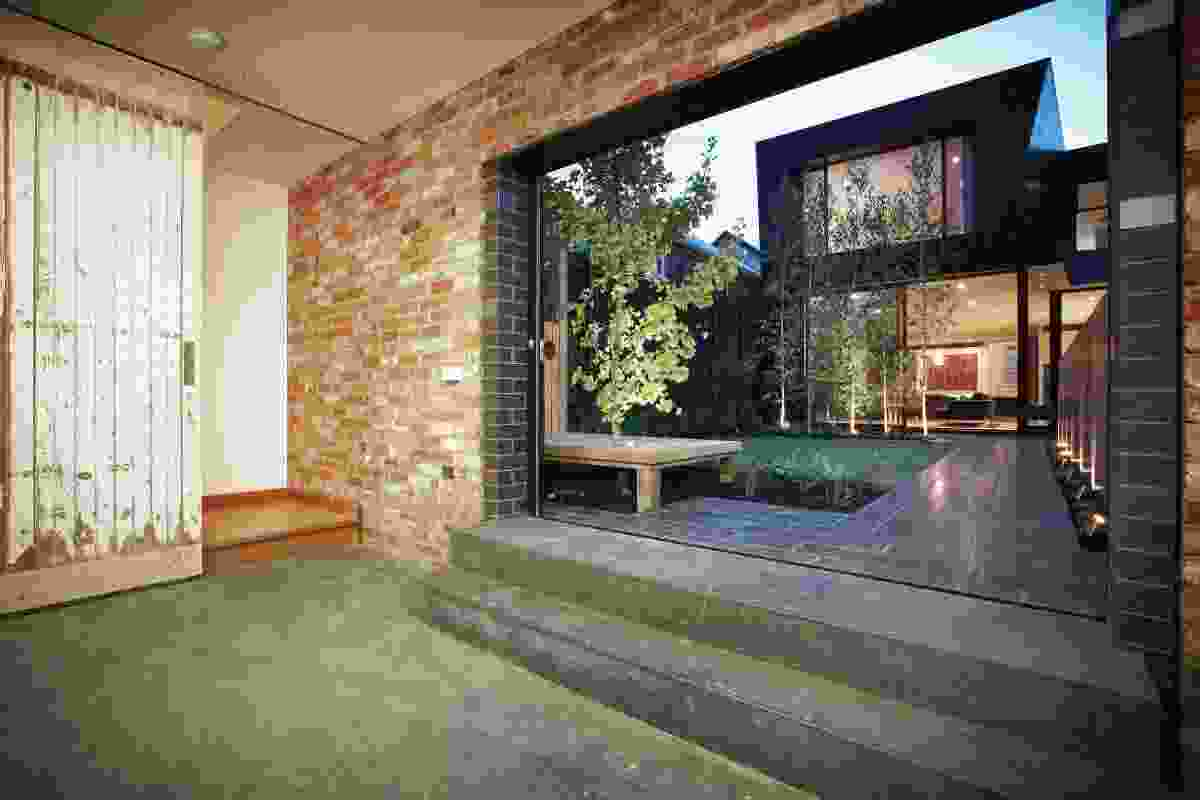 Looking from the garage toward the main living spaces across the internalized garden.