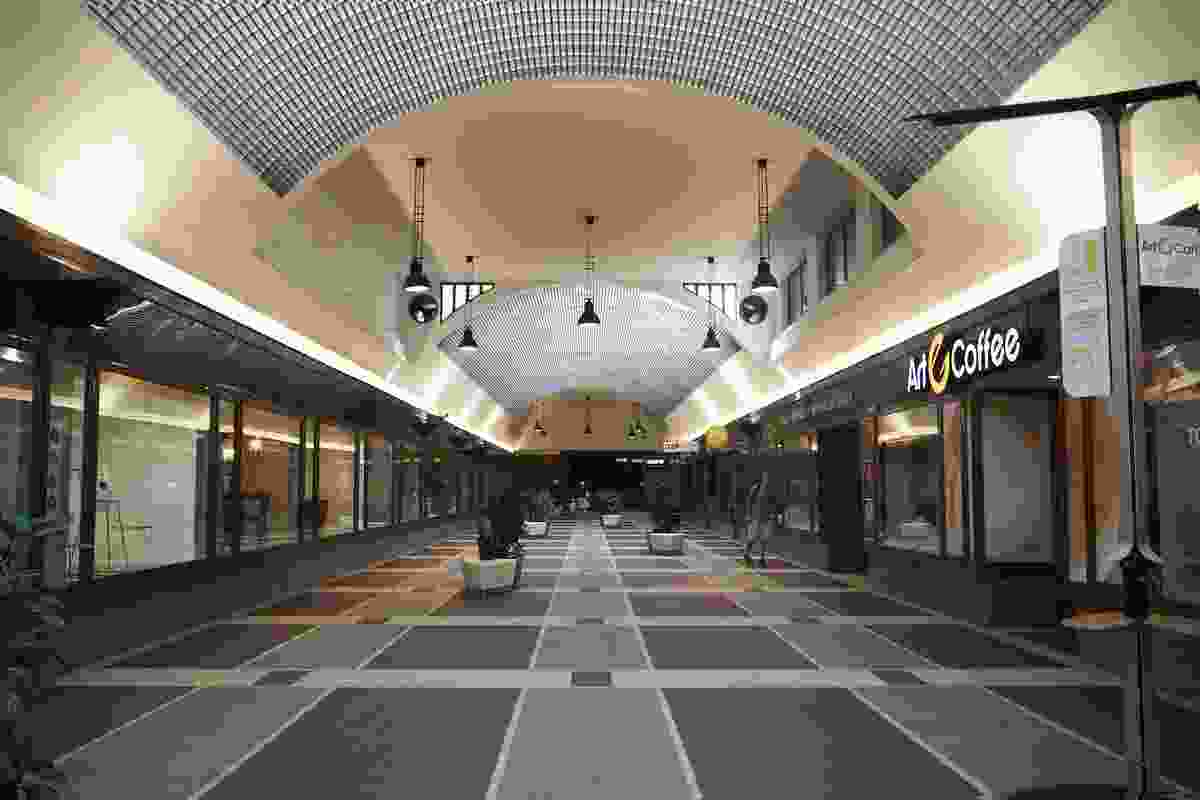 A Functionalist passageway with an arched ceiling of glazed bricks.