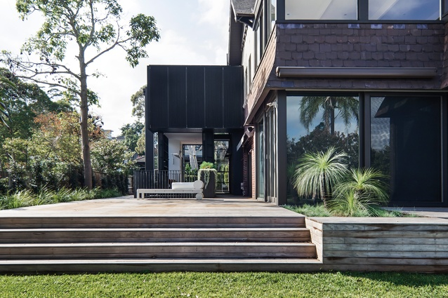 "With its dark palette and small footprint, the project reads as a ""black stealth addition."""