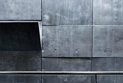 Wall detail of the massive concrete atrium within the Access and Language Building at Chisholm Institute's Dandenong campus.