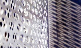 Light through the perforated balcony structures.