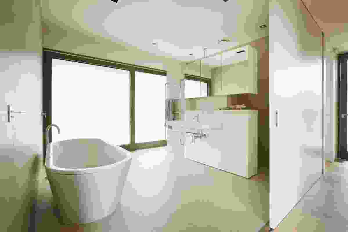 The bathroom can be opened to the outdoors via opaque sliding doors.