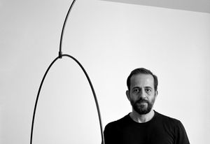 Michael Anastassiades with the Mobile Chandelier 9 for Flos. Photograph: Hélène Binet.