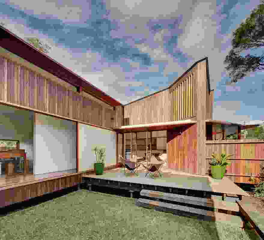 The house is planned around a sunny landscaped courtyard at the front of the site.