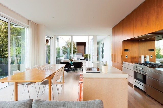 The kitchen is opened to a central courtyard via large sliding glass panels.