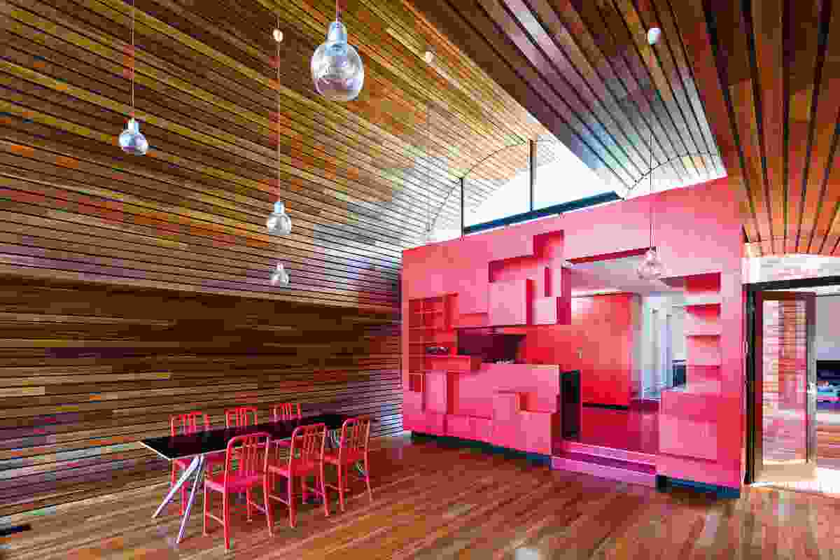 "The red kitchen box is an ""oversize toy in the mind of the architects."""