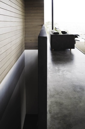 Polished concrete floors paired with bleached timber walls.