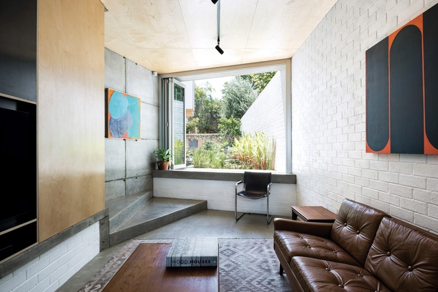 The overlay of plywood lining softens the effect of the honed concrete and brick surfaces. Artwork (L-R): Giles Hohnen; Trevor Richards.