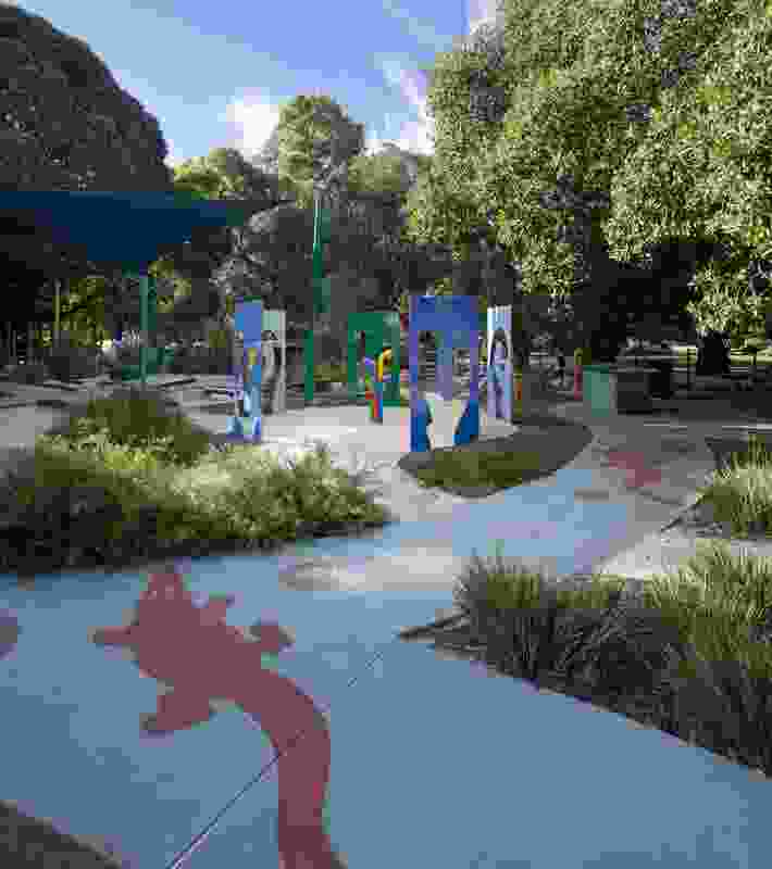 Stencilled crocodiles and lily pads float on the coloured concrete river that winds through the site.