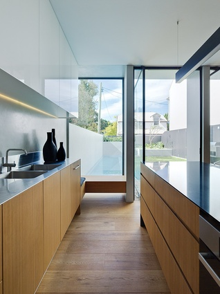 The kitchen is simple and welcoming, with a timber window seat adjacent to the pool.