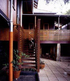 Looking towards the new verandah, designed by Bruce Eeles and Associates, with the existing cottage beyond.