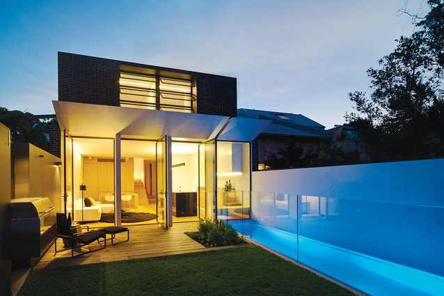 The small rear backyard features a plunge pool along the western boundary.