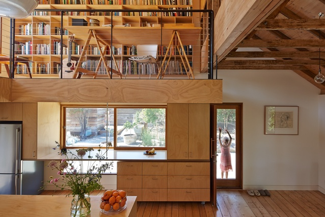 The floating corner of the mezzanine study floor is hung from a roof beam via a fine steel rod.