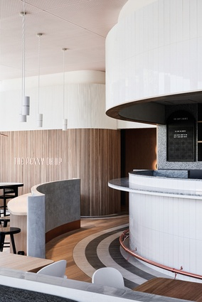 The curved form of the bar was inspired by the concept of Pennies dropping into the cafe.