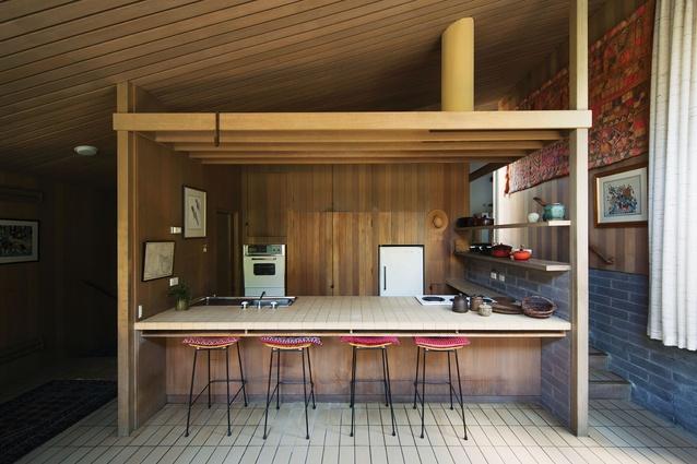 A beam structure defines the kitchen.