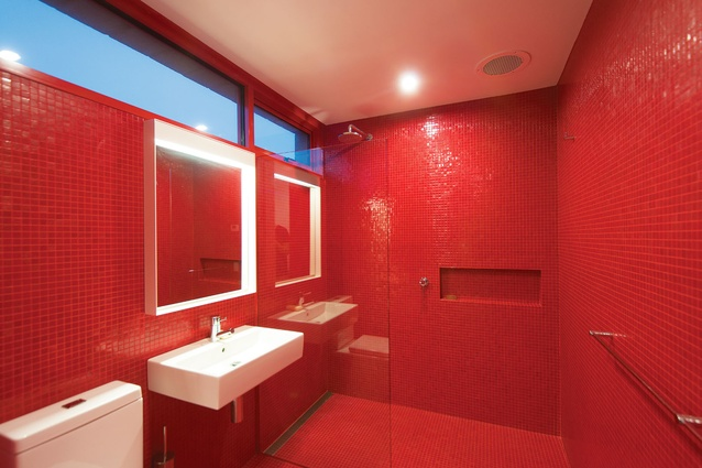 A Stanley-Kubrick-style all-red bathroom.