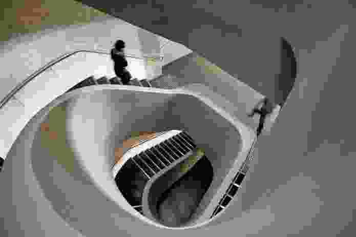 A concrete stair coils through the building.