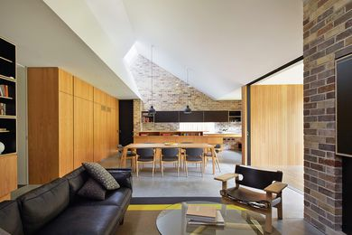 Skylight windows angled toward the south-east allow subtle daylight to fall into the new living spaces.
