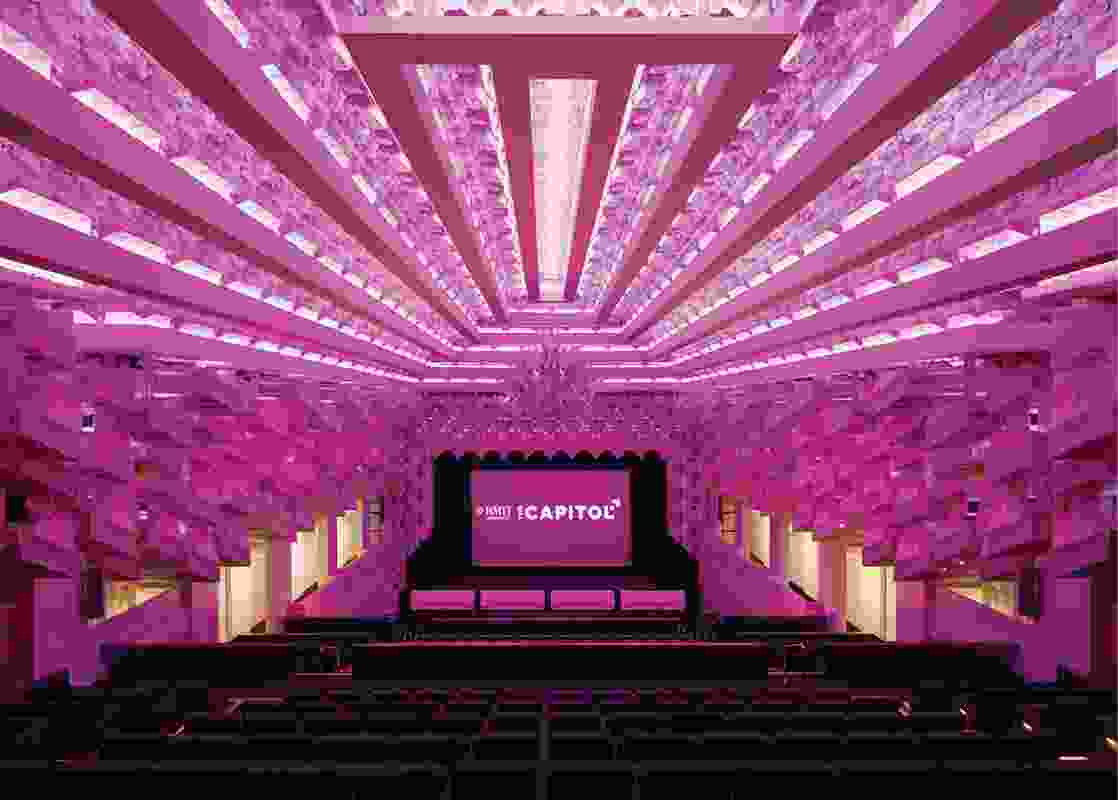 The vast plaster ceiling features copiously repeated prismatic forms, housing lights that can be varied in colour and intensity.