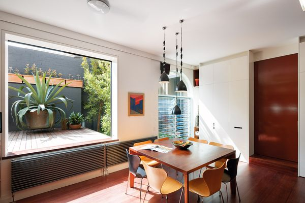 Existing windows were enlarged and new ones added to bring light and a courtyard connection to the interior. Artwork: Kathie Peak.