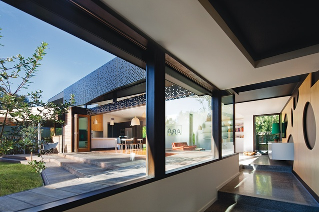 A glazed corridor looks out over a courtyard, leading from the front to the rear wing.
