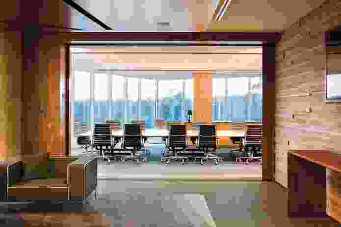 In this meeting room natural light is maximized via full-height windows.