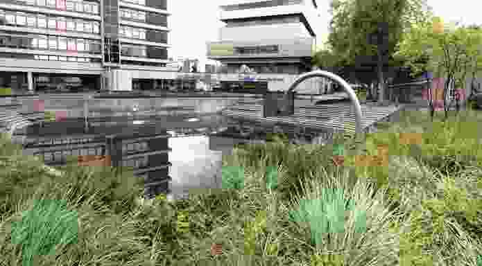 In Rotterdam, Water Square Benthemplein by De Urbanisten stores water temporarily after heavy rain.