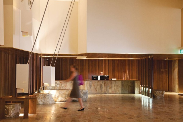 Bespoke, built-in furniture, Chillagoe marble surfaces and spotted gum framing fill the ground-level lobby.