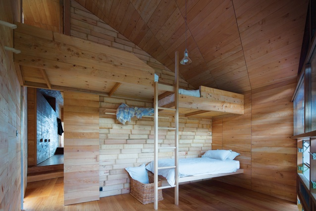 Apple crates from old orchards in the Huon Valley clad the bedroom interiors.