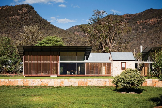House in Country NSW (2010): Built around a former bushranger's cottage, its steel roofs lifting up to frame the tops of the surrounding mountains.