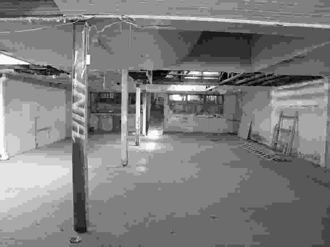 Interior view of condition of showroom prior to restoration.
