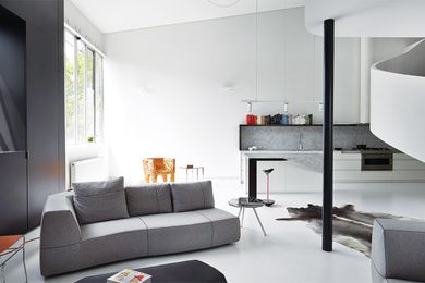 The spare colour palette and pared-back materials allow the dramatic forms of the architecture to come to the fore.