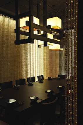 Spice Temple dining areas are defined by screens and curtains.