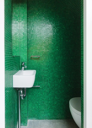 Bright green glass mosaic tiles line the second bathroom.