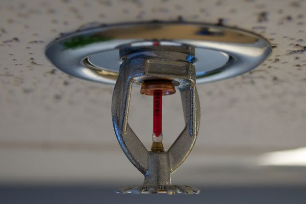 The National Construction Code may change to make fire sprinklers mandatory on all covered balconies in multi-storey buildings.