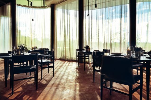 The restaurant showcased Danish design, including Carl Hansen furniture and Kvadrat fabric curtains .