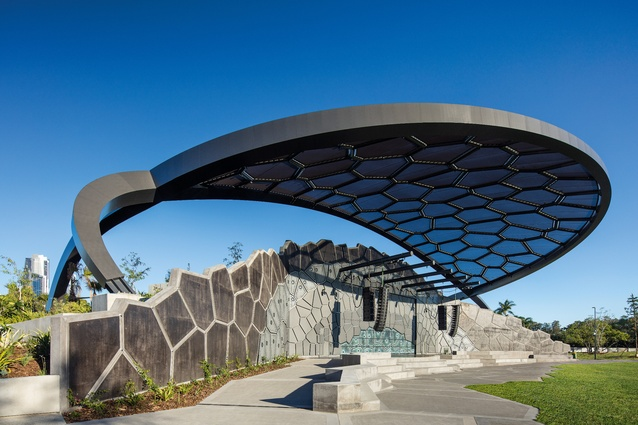The flattened geometry of the amphitheatre and its angular concrete steps are shaded by the distinctive fabric canopy above.