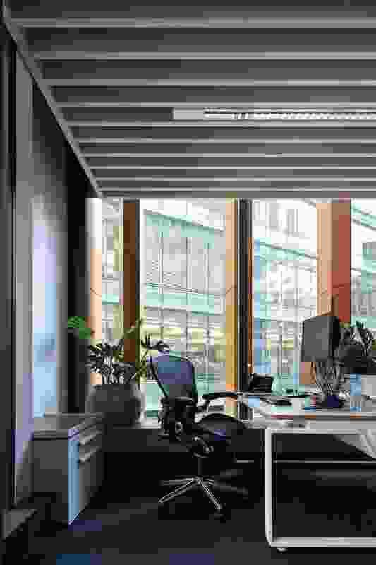 """The office has a relaxed aesthetic that """"feels more like a friend's home"""" than the office of a building company."""